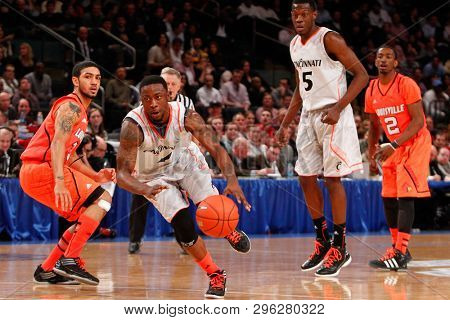 NEW YORK-MAR 10: Cincinnati Bearcats guard Cashmere Wright (1) drives the ball past Louisville Cardinals guard Peyton Siva (3) at the Big East Tournament on March 10, 2012 at Madison Square Garden.