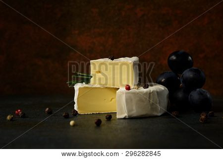 Cheese Camembert Or Brie With Dark Grapes