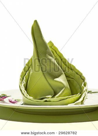 Green napkin on white background