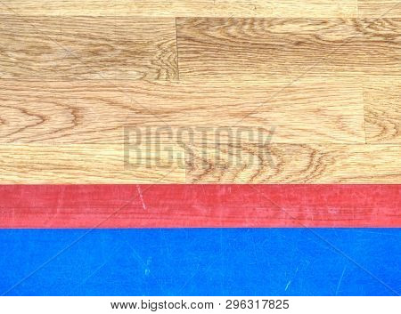 Red playfield line in blue square. Marks on fooden floor of sports gymnasium. Ground colorful marking lines poster