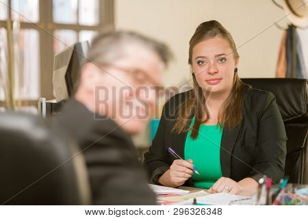 Happy Young Professional Woman In Her Office With Colleague