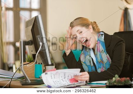 Overworked Creative Professional Woman Screaming At Her Desk