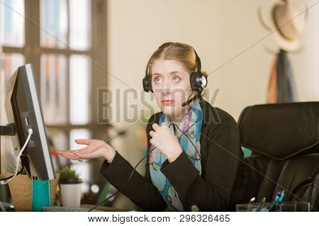 Young Professional Woman On A Headset Call
