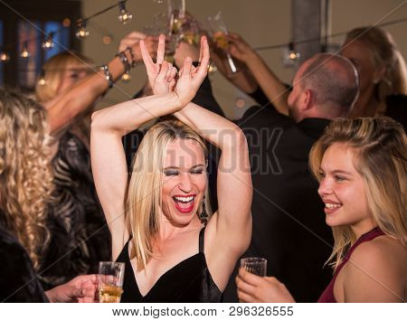 Pretty Mature Woman Having Fun Dancing At A Party Or Reception