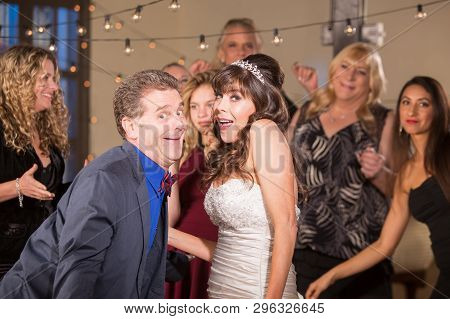 Bride And Man Doing Funny Dance At A Wedding