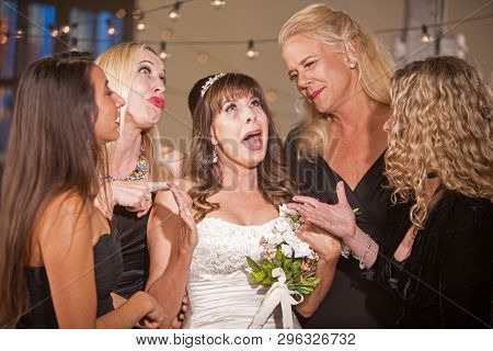 Upset Mature Bride With Her Friends At A Wedding