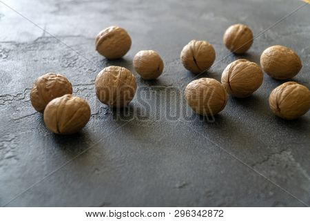 Bunch of whole walnuts on gray slate surface. Healthy diet composition, background