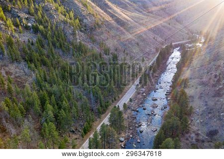 aerial view of mountain river at sunset - Poudre River below Mishiwaka, Colorado in early spring