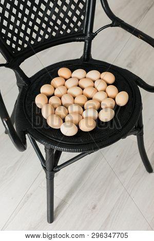 eggs on the black armchair