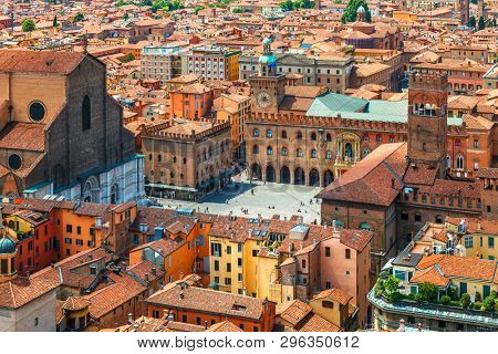 poster of Italy Piazza Maggiore in Bologna old town tower of town hall with big clock and blue sky on background, antique buildings terracotta galleries.
