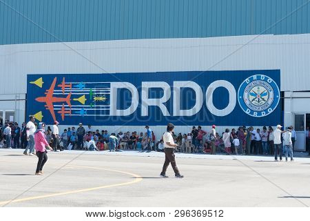 Bengaluru, India - February 22, 2019: Visitors At The Aero India 2019 Rest From The Shade Outside Th