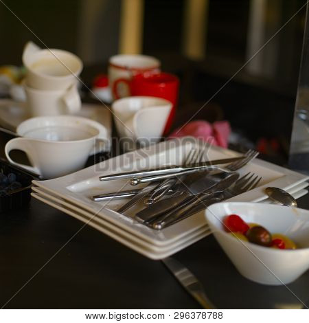 Mess In A Litchen After A Meal Finished With A Pile Of Unwashed Dishware
