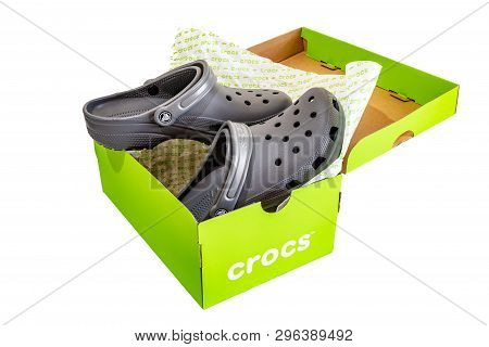 Montego Bay, Jamaica - April 19 2019: Pair Of New Grey Classic Crocs Shoes And Packaging Box Isolate