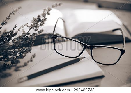 Black And White Memory Of A Romantic Sentimental Still Life With A Diary, A Book, Flowers, Glasses A