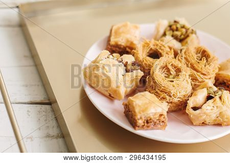 Assorted Baklava Served On A Metal Tray. Traditional Arabic Dessert