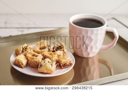 Assorted Baklava On A Small Plate And Cup Of Coffee Served On A Metal Tray. Traditional Arabic Desse