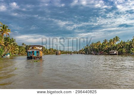Houseboats In The Backwater Of Alleppey Kerala Showing The Natural Beauty Of South India. Image Take