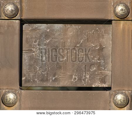Vintage Rectangular Plate In Metal Frame With Rivets.