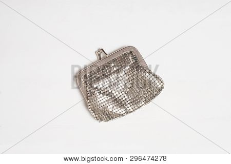Silver-plated Metal Wallet Isolated On A Light Background.