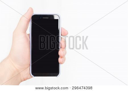 Male Hand With A Smartphone. Black Blank Screen. White Background. Isolate