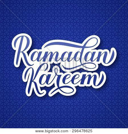 Ramadan Kareem Calligraphy Lettering On Blue Arabic Pattern  Background. Muslim Holy Month Typograph