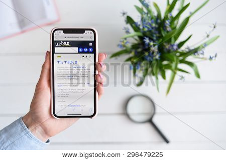 Kharkiv, Ukraine - April 10, 2019: Woman Holds Apple Iphone X With Urbandictionary.com Site On The S