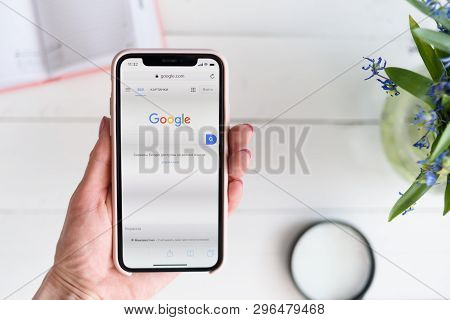 Kharkiv, Ukraine - April 10, 2019: Woman Holds Apple Iphone X With Google.com Site On The Screen. Se