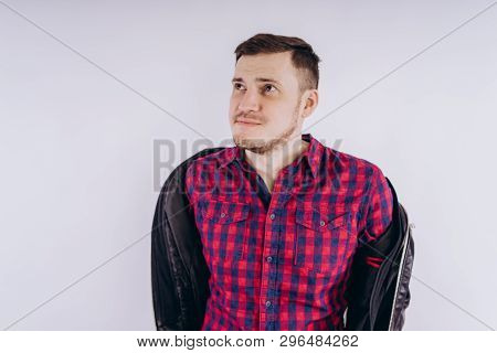 Cool Man With Jacket On Shoulder Portrait Of Young Handsome Male In Red Plaid Shirt Holding Leather