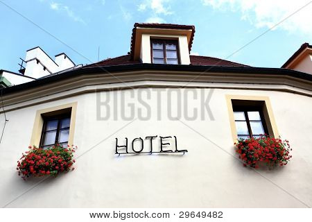 Wall of hotel close-up with windows and singboard