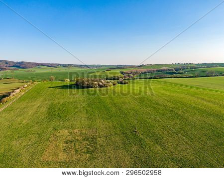 Aerial View Of Agriculture Land. Fields And Meadow During Sunny Summer Day. Trees And Bushes On Agri