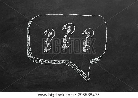 Hand Drawing Question Marks  On Black Chalkboard.