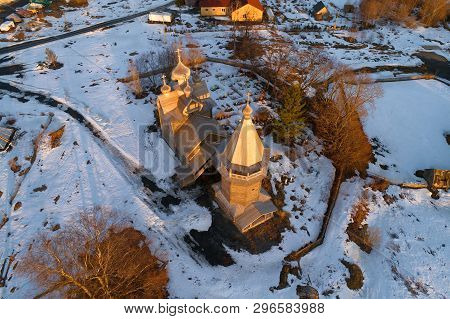 Aerial View Of The Ancient Wooden Church Of Dmitry The Theunal Myrrh-stream In April Evening (aerial