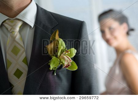 Husband With Corsage And Bride Behind