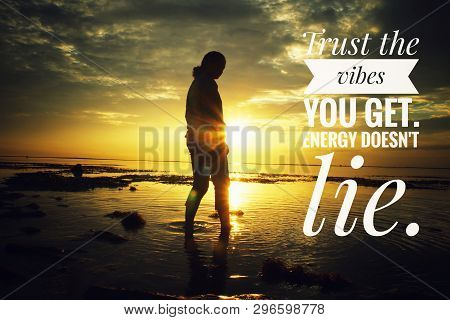Inspirational Motivational Quote- Trust The Vibes You Get.  Energy Does Not Lie. With Woman Silhouet