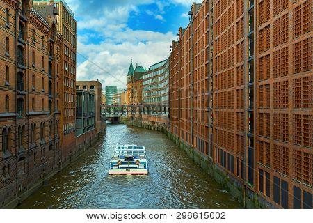 The Speicherstadt Is Popular Landmark Of City Hamburg In Germany. Multi-storey Buildings Stand On Ti