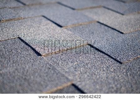 Close Up View On Asphalt Roofing Shingles Background. Roof Shingles - Roofing.