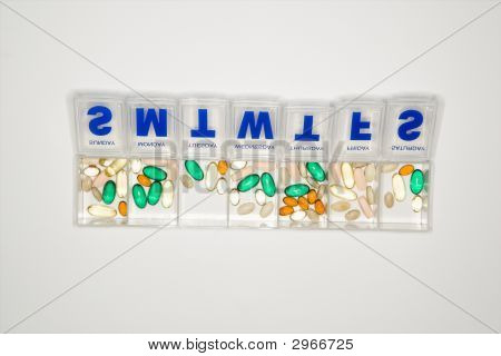 Container With Pills.
