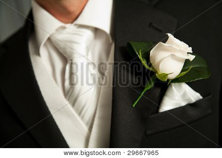 Close Up Of A White Rose Corsage On A Groom