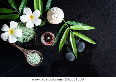 Thai Spa.  Top View Of White Plumeria Flower Setting For Massage Treatment And Relax On Black Blackb