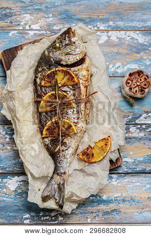 Baked Fish Dorado. Baked Dorado Fish And Ingredient For Cooking. Fish Gilt-head Bream Dorade With Sa