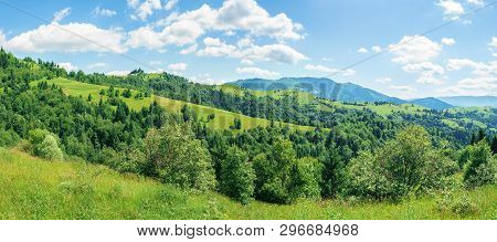Panorama Of Mountainous Countryside In Summer.  Rural Fields On Grassy Hills. Ridge In The Distance.