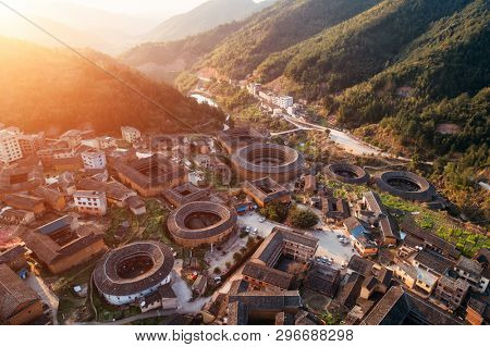 Aerial view of Tulou at sunset, the unique dwellings of Hakka in Fujian, China. poster