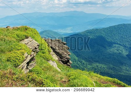 Beautiful Summer Mountain Landscape. Stunning View From The Edge Of A Hill With Huge Rock. Grassy Sl