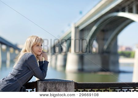 Beautiful Woman With Bridge On The Background