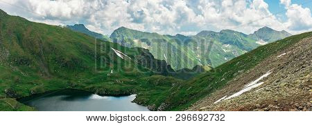 Panorama Of A Fagaras Mountains In Summer. Lake Between The Hills. Beautiful Scenery Of Romania. Won