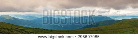 Panorama Of A Gorgeous Summer Landscape. Overcast Weather. Mountain Ridge In The Distance