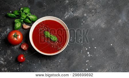 Traditional Spanish Cold Tomato Soup Gazpacho In A White Bowl On A Dark Stone Background. Traditiona
