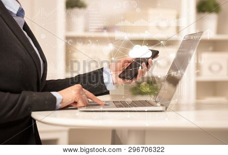 Business woman in homey environment using laptop with cloud technology concept