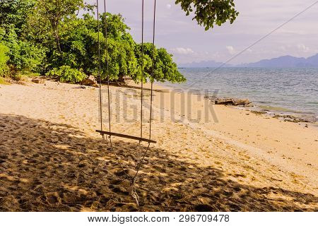 An Empty Simple Wooden Swing On Tropical Beach, South Of Thailand