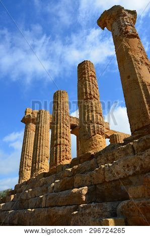 Ancient Doric Architecture Of Acropolis Temple Of Juno. Valley Of The Temples In Agrigento On Sicily